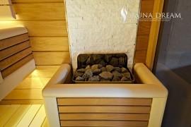 Saunová kamna Harvia s luxusním krytem a kemennou stěnou